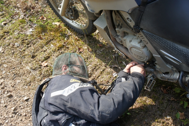 "BamBam fixing the shifter, again, on Kim's ""Dakar"""
